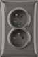 Zásuvka dvojnásobná s ochrannými kolíkmi, s clonkami, s natočenou dutinou, grafitová šedá